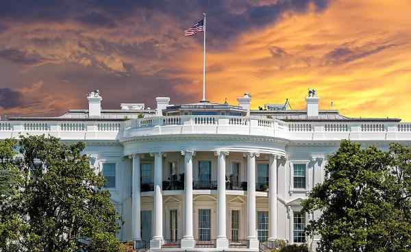 White House on deep red sunset background 382759309